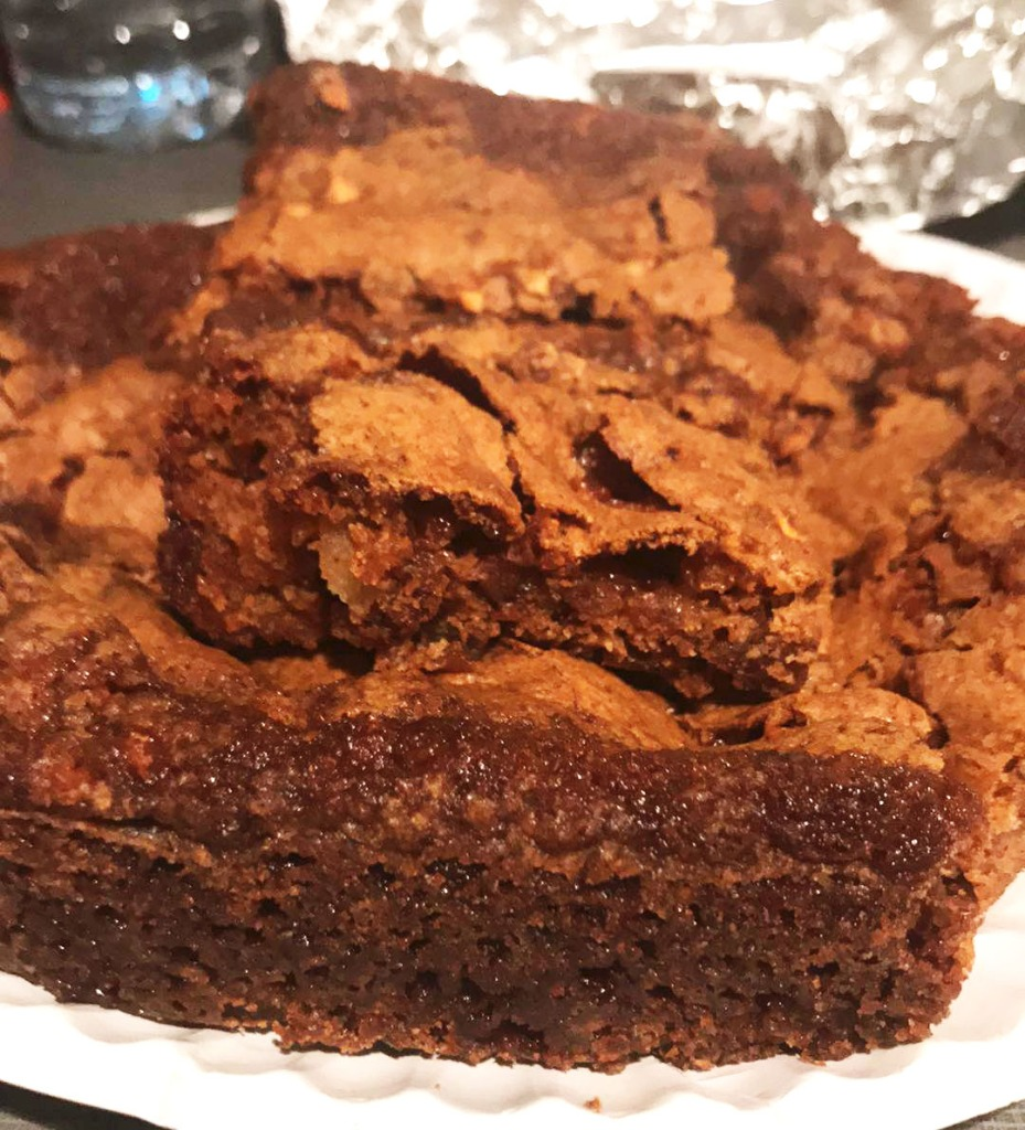 Baked apple cake with almost brownie texture.