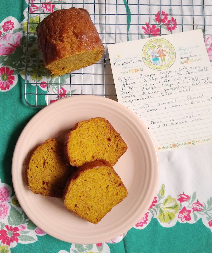 Sliced Pumpkin Spice bread. Vintage recipe card beside.