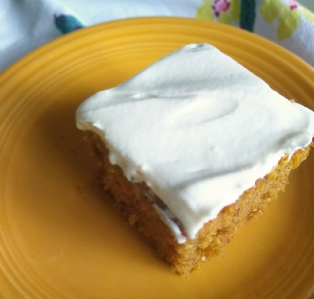 Creamy white cream cheese frosting on a pumpkin cake.